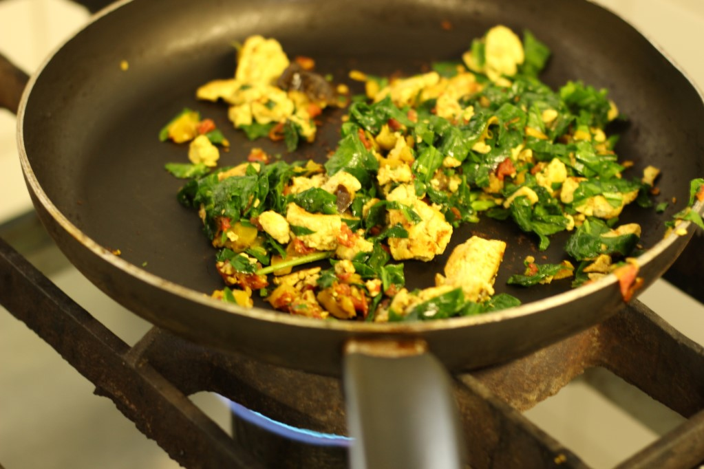 Tofu scramble cooking in the pan at Free Food*